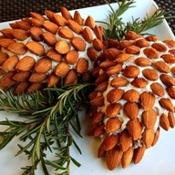 Almond covered pine cone, try using spiced almonds or marcona almonds with rosemary for a different spin