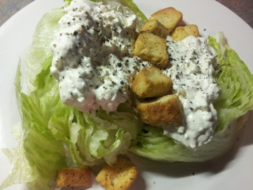 Delicious wedge, topped with garlic croutons and blue cheese dressing