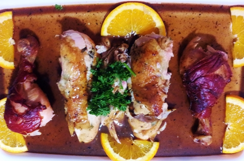 Citrus roasted chicken with prosciutto wrapped drumsticks